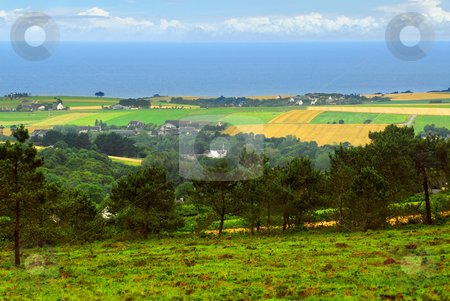 Landscape in Brittany stock photo, Agricultural landscape with scenic ocean view in rural Brittany, France by Elena Elisseeva
