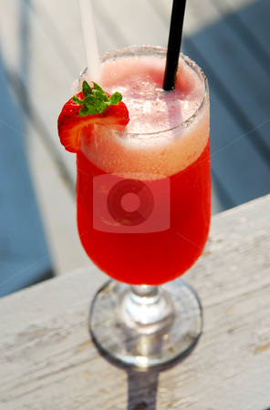 Strawberry daiquiri stock photo, Strawberry daiquiri cocktail served in a cold glass outdoor by Elena Elisseeva