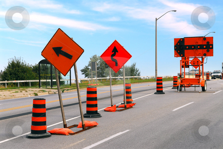 Road construction stock photo, Road construction signs and cones on a city street by Elena Elisseeva