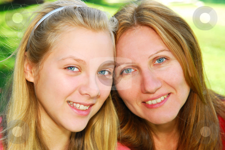 Mother and daughter stock photo, Portrait of mother and daughter in summer park by Elena Elisseeva