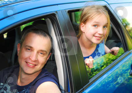 Family trip stock photo, Father and daughter sitting inside the car ready to go on family trip by Elena Elisseeva