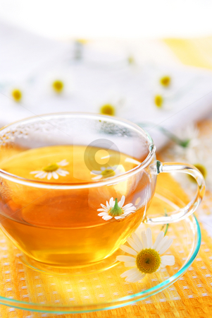 Chamomile tea stock photo, A teacup with soothing herbal camomile tea by Elena Elisseeva