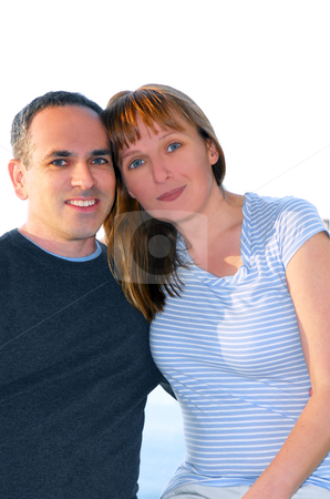 Attractive couple stock photo, Portrait of an attractive romantic couple, white background by Elena Elisseeva