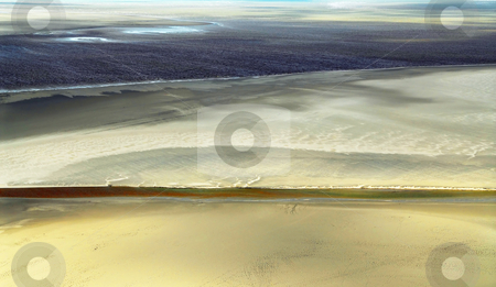 Ocean at low tide stock photo, Aerial view of Atlantic ocean at low tide near Mont Saint Michel abbey in France. Background. by Elena Elisseeva