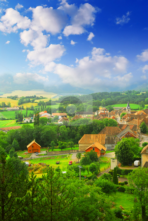 Rural landscape stock photo, Rural landscape with hills and a small village in eastern France by Elena Elisseeva