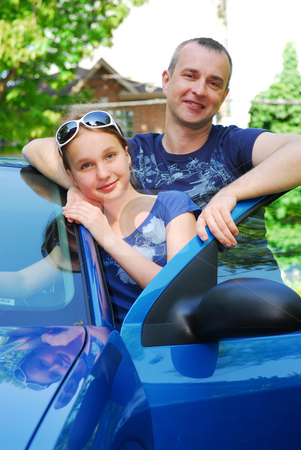 Family trip stock photo, Father and daughter standing near the car ready to go on family trip by Elena Elisseeva