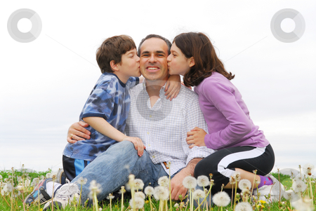 Happy family stock photo, Grateful children giving their father a kiss by Elena Elisseeva
