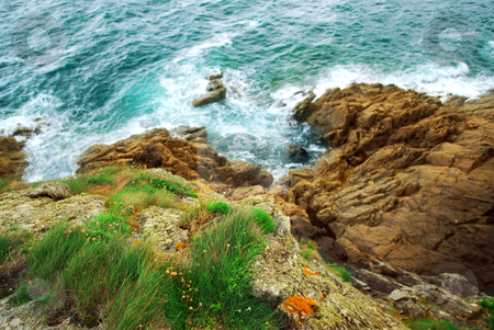 Cliffs at the ocean stock photo, View down the cliffs at Atlantic ocean coast in Brittany, France by Elena Elisseeva