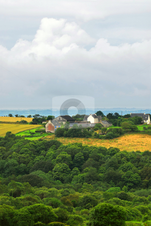 Agricultural landscape stock photo, Scenic view on agricultural landscape with a farm house in rural Brittany, France by Elena Elisseeva