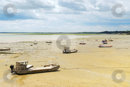 Fishing boats in Cancale, France stock photo, Fishing boats on the ocean floor at low tide in Cancale (Brittany, France) by Elena Elisseeva