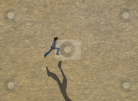 Taking off stock photo, A child running in a field in France by CRISTINA TOSI