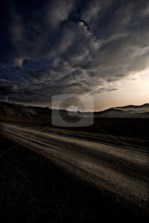 ... a country road on a winter evening stock photo,  by emiliano beltrani