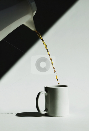 Monochromatic Coffee Pour stock photo, Coffee pour frozen in motion by a fast shutter speed. by Scott Griessel