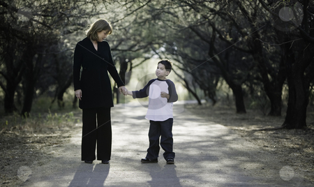Boy with Mother stock photo, Young boy with his mother on a tree-lined path. by Scott Griessel