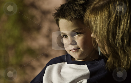 Boy with Mother stock photo, Young boy with his mother looks to the distance. by Scott Griessel