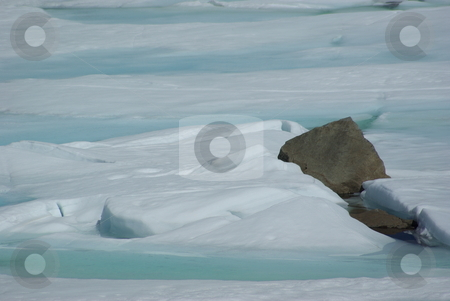 Blue Ice And Rocks stock photo, Spring ice breakup and rocks on a high Sierra lake. by Lynn Bendickson