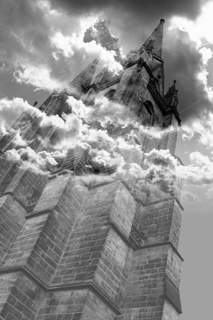 Gothic horror tower stock photo, The ancient tower stands out against the sky and the clouds completely wraps it in a mystery glow by Dario Rota