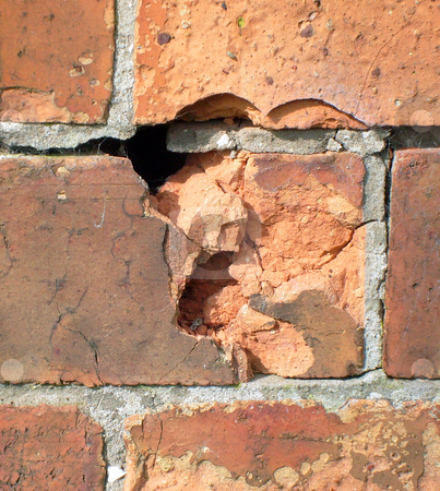 Weathered brick stock photo, Detail of weathered brick in traditional wall. by Martin Crowdy