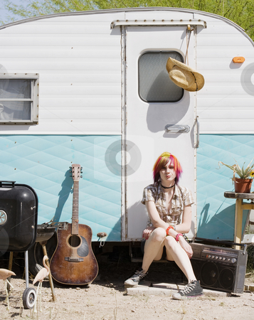 Girl Sitting on a Trailer Step stock photo, Punk girl with brightly colored hair sitting on a trailer step by Scott Griessel
