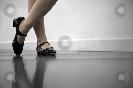 Tap Dance Class stock photo, Young dancer... low angle shot of just feet and legs - this view has had the color removed from the floor and wall. by Mitch Aunger