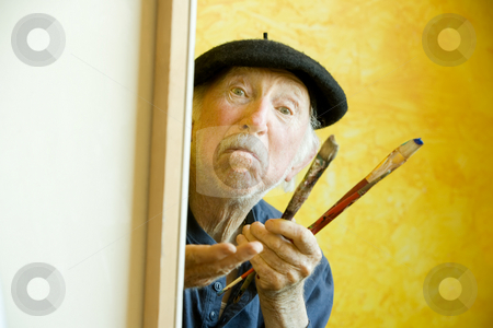 Artist with a Beret at a Canvas looking at model stock photo, Elderly painter wearing a beret working on a large canvas and looking up by Scott Griessel
