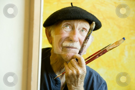 Artist with a Beret at a Canvas looking up stock photo, Elderly painter wearing a beret working on a large canvas and looking up by Scott Griessel