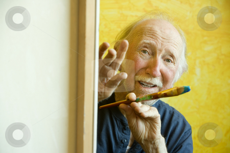 Artist at a Canvas stock photo, Elderly painter working on a large canvas by Scott Griessel