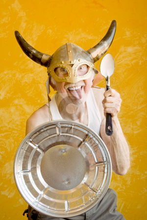 Crazy Old Man in a Viking Helmet stock photo, Crazy Old Man in a Tee-Shirt and a Viking Helmet by Scott Griessel