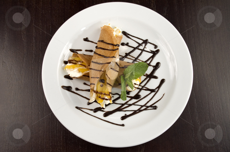Pancakes with fruit. stock photo, Pancakes with fruit, whipped cream in chocolate. by Yury Ponomarev