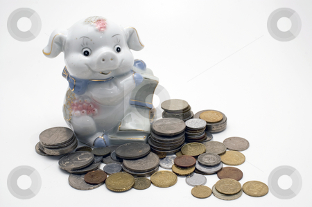 Piggy bank. stock photo, Piggy bank swine. Coin pile isolated on white background. by Yury Ponomarev