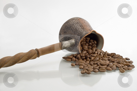 Turkish coffee pot. stock photo, Turkish coffee pot and coffee grains on a white background. by Yury Ponomarev