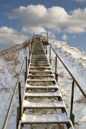 Ladder. stock photo, Ladder on a snow mountain on a background of the light-blue sky. by Yury Ponomarev