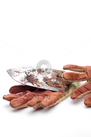 Dirty worn gardening gloves  stock photo, Dirty worn gardening gloves with a garden spade by Vince Clements