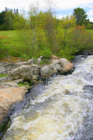 Rushing Stream stock photo, A rural stream in the Spring, showing fast movement of water by Tom and Beth Pulsipher