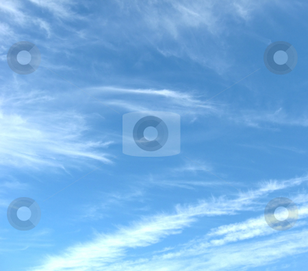 Whispy Clouds stock photo, Whispy clouds on a blue sky day, showing diagonal formations on the lower right by Tom and Beth Pulsipher