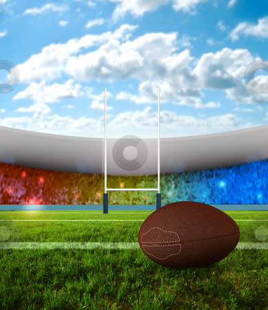 Rugby penalty kick stock photo, Rugby ball on field with stadium of background by Giordano Aita