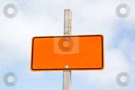 Empty road sign stock photo, Bright orange road sign over cloudy sky by Olena Pupirina