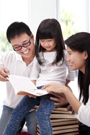 Happy asian family studing together. Parent helping daughter  reading book stock photo, Happy asian family studing together. Parent helping daughter  reading book by tomwang