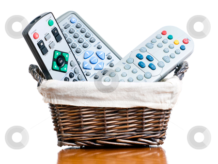 Tv Basket stock photo, Small basket full of several various TV remote controllers.... by Sinisa Botas
