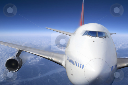 Airplane stock photo, A passenger jet flying high above the clouds.  by © Ron Sumners