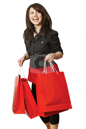 Very happy shopping girl stock photo, A very happy shopping girl holding bags and smiling wildly about her rabid consumerism. by © Ron Sumners