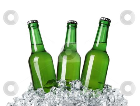 Bottles on ice stock photo, Bottles on ice isolated on white background by krasyuk