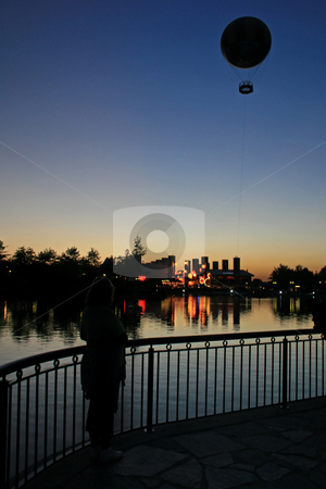 Balloon Sunset stock photo, The Silhouettes of Buildings and a Balloon at Sunset by Lucy Clark