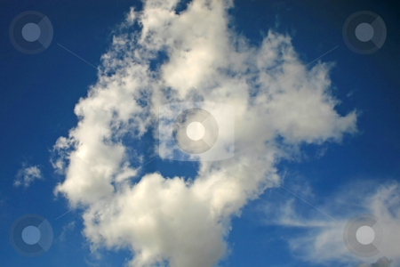 Clouds stock photo, A fluffy cloud in the blue sky by Lucy Clark