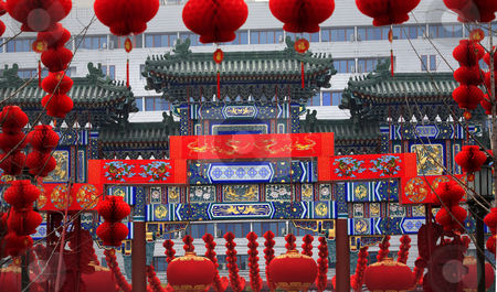 Ornate Chinese Gate  Lucky Red Lanterns Chinese Lunar New Year D stock photo, Ornate Chinese Gate Lucky Red Lanterns Chinese New Year Decorations Stone Gate Ditan Park Beijing China.  During Lunar New Year, many parks and temples in China have large outdoor fairs, festivals.  Chinese characters on lanterns say lucky and long life. by William Perry