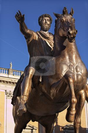Emperor Marcus Aurelius Bronze Equestrian Statue Capitoline Hill stock photo, Emperor Marcus Aurelius Bronze Equestrian Statue Capitoline Hill Against Blue Sky Details Front of the Museum Rome Italy   by William Perry