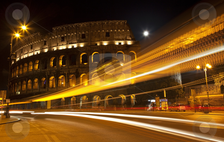 Colosseum Street Abstract Night Moon Rome Italy stock photo, Colosseum Modern Street Abstract Night Moon Time Lapse Rome Italy Built by Vespacian   Resubmit--In response to comments from reviewer have further processed image to reduce noise, sharpen focust and adjust lighting.  Trademarks obscured. by William Perry