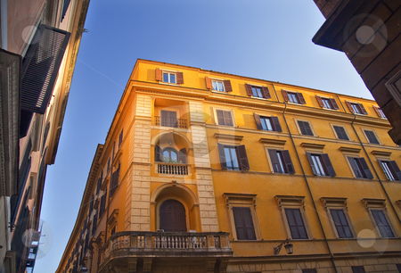 Bright Yellow Builidng Blue Skies Roman Streets Rome Italy stock photo, Bright Yellow Builidng Blue Skies on the Roman Streets Via Della Pigna Rome Italy   by William Perry