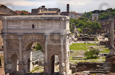 Septemus Severus Arch Titus Arch Forum Rome Italy stock photo, Septemus Severus Arch Forum Rome Italy Stone arch was built in the memory of Emperor Septemus Severus, who reigned from 193-211AD, and his sons  Titus Arch in Distance   by William Perry