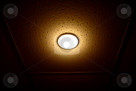 Lamp on the ceiling stock photo, One lamp on the ceiling isolated on black by vetdoctor